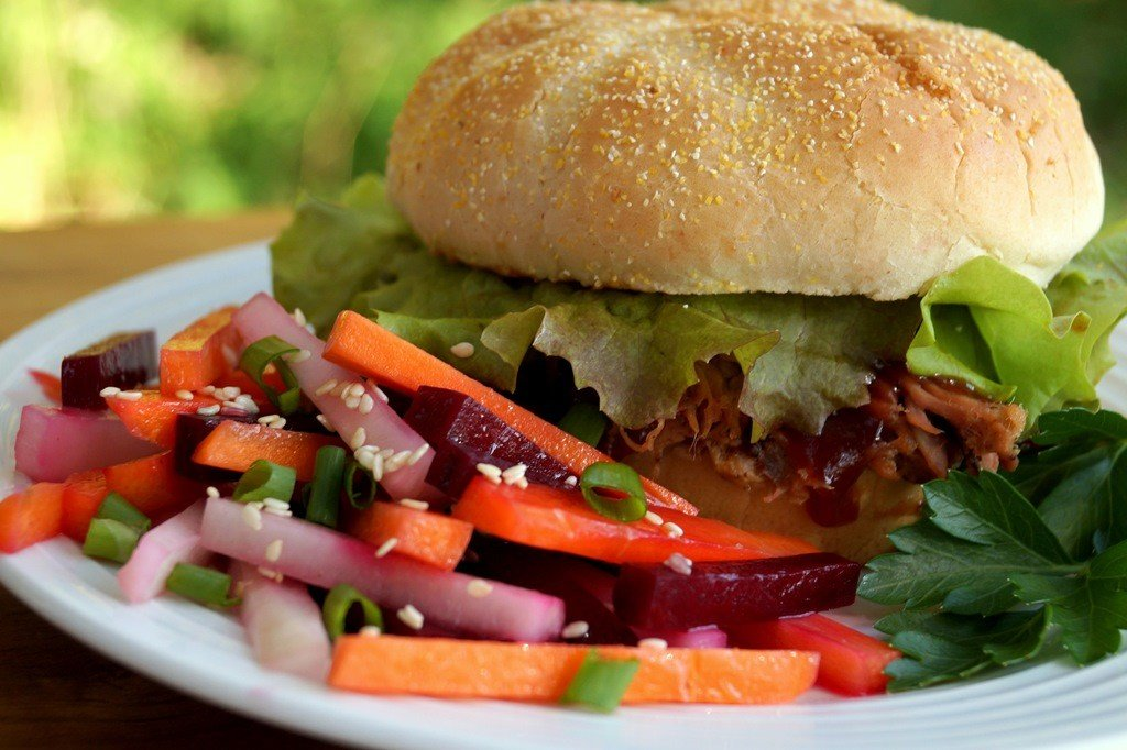 pork sandwich with beet carrot and radish salad
