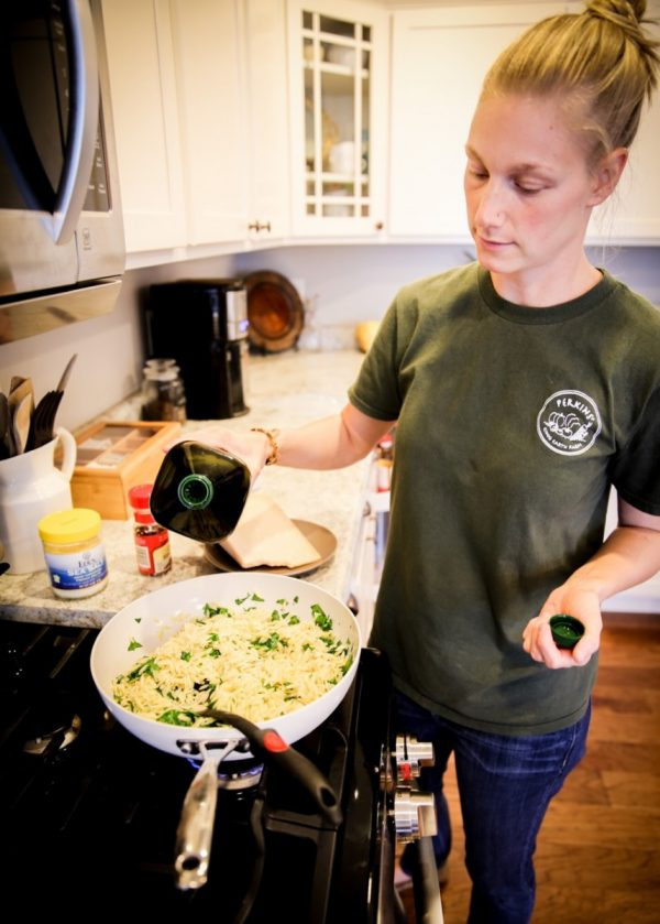Trisha Belstra prepping orzo with spinach and garlic