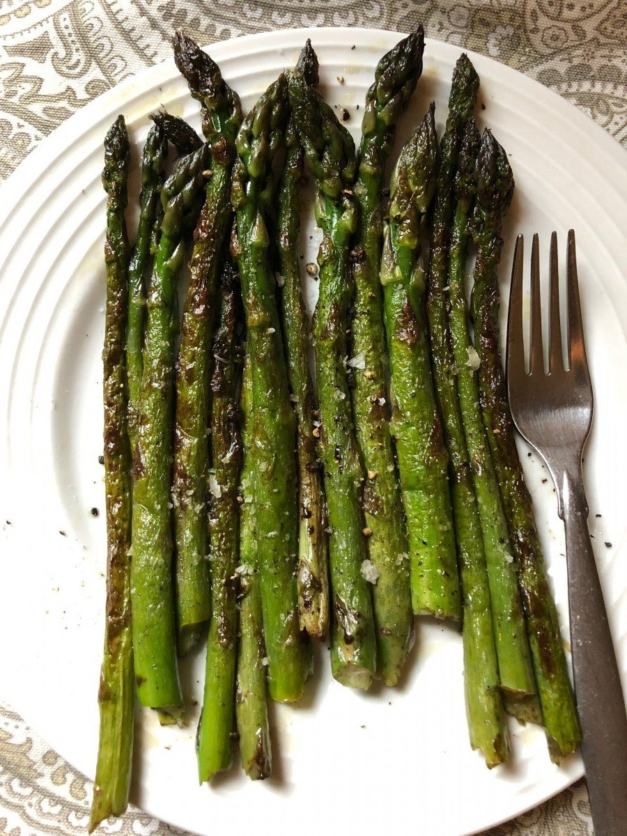 sauteed asparagus on white plate