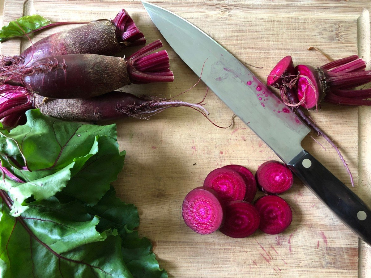 fresh beets on cutting boards