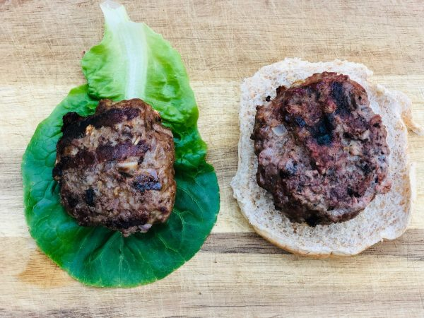 black garlic burger with lettuce leave