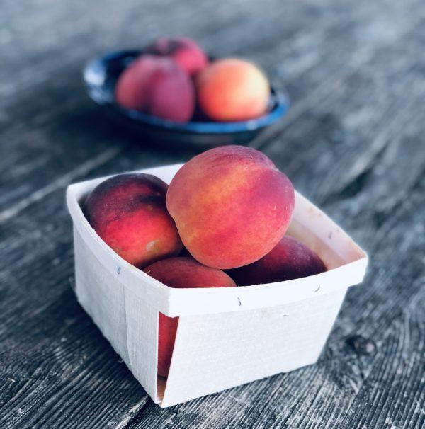 peaches on farm stand