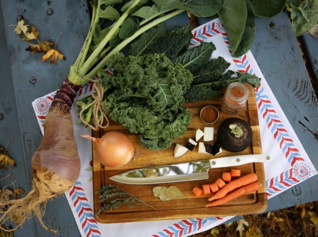 ingredients for fall stew with rutabagas, roots, and greens